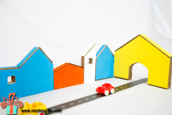 DIY recycled cardboard toy for boys and girls: a colorful cardboard town | at Non Toy Gifts