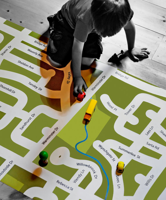 Giant neighborhood play mats that will help kids get familiar with their local streets while riding their toy cars on these custom-designed road maps - at Non Toy Gifts