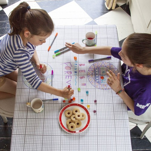 Four tablecloths for kids that will engage them in unique ways at the table, without distracting but rather keeping them occupied while eating.