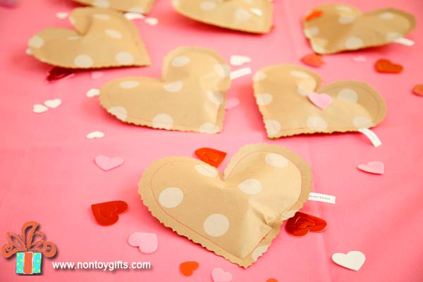 Simple DIY Valentine's Day treat bags to make from wrapping paper. Free printable. - at Non Toy Gifts