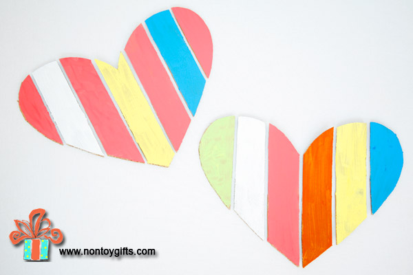 A simple and fun Valentine craft for preschoolers. Make a heart and paint it. Homeschool or classroom Valentine activity. The outcome of this craft is a kid made Valentine decoration. Fun!