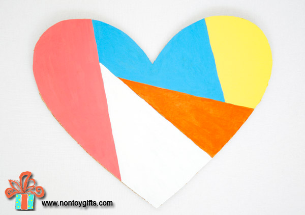 Simple DIY upcycled Valentine decoration made from a cardboard box.