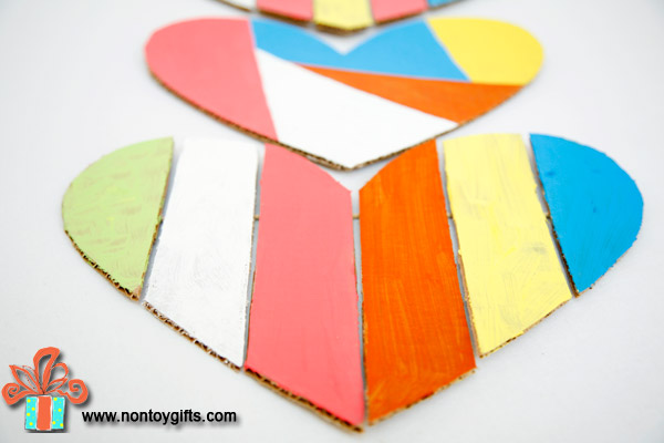 Kid Made Valentin Hearts made from cardboard. This isn't only a fun craft for toddlers and preschoolers but the outcome can be used as a Valentine decoration. Colorful cardboard craft for kids.
