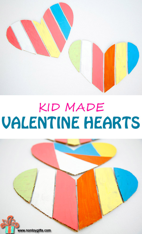 A beautiful kid made Valentine decoration made from cardboard. An upcycled DIY decoration to proudly display over the fireplace. Cut, paint and enjoy! A fun Valentine craft for kids.