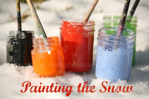 Pain the snow - one of the 20 outdoor snow activities for kids. Be prepared for that snowy day when school is off and kids want to go outside and play. This list of snow and ice activities for kids of all ages is just what you need for any winter day. | at Non Toy Gifts