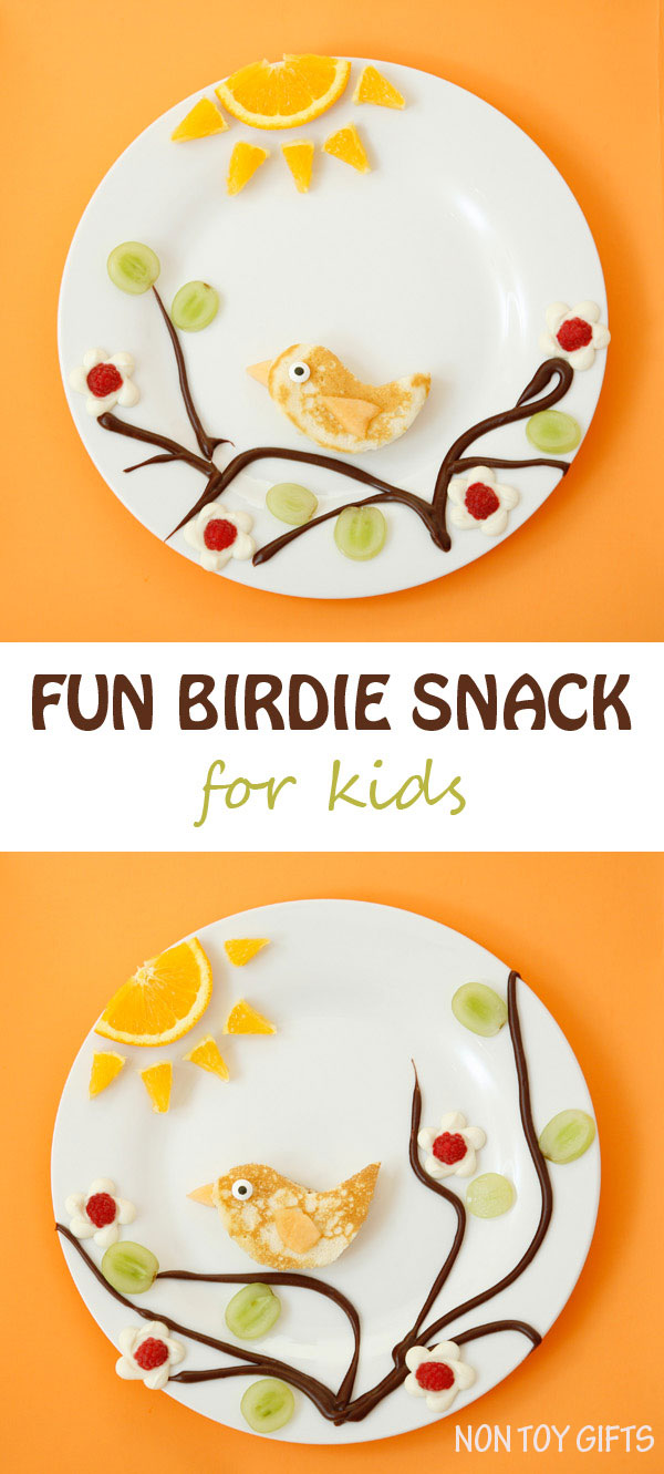 A fun and healthy birdie snack for kids. It incorporates fresh fruits (orange, raspberry, cantaloupe and grapes), pancake and chocolate into a cute design that kids will love | at Non Toy Gifts