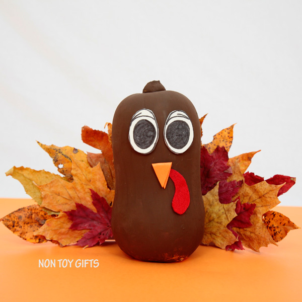 Easy Thanksgiving craft for kids. Make a turkey using a butternut and autumn leaves. | at Non-Toy Gifts