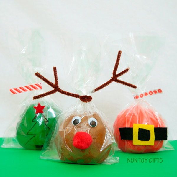 Christmas play dough. Homemade play dough that looks like Santa, Christmas tree and reindeer. Great winter activity for kids or DIY stocking stuffer. Easy craft.   at Non Toy Gifts