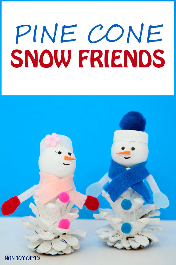 Pine cone snow friends. A snowman and snow woman craft for kids to try this winter when it's too cold to play outside. | at Non Toy Gifts