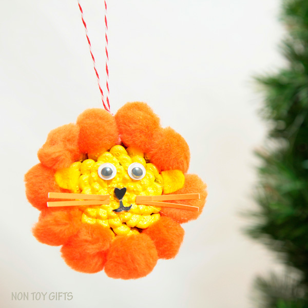 DIY pine cone lion ornament. Fun winter craft for kids. | at Non-Toy Gifts