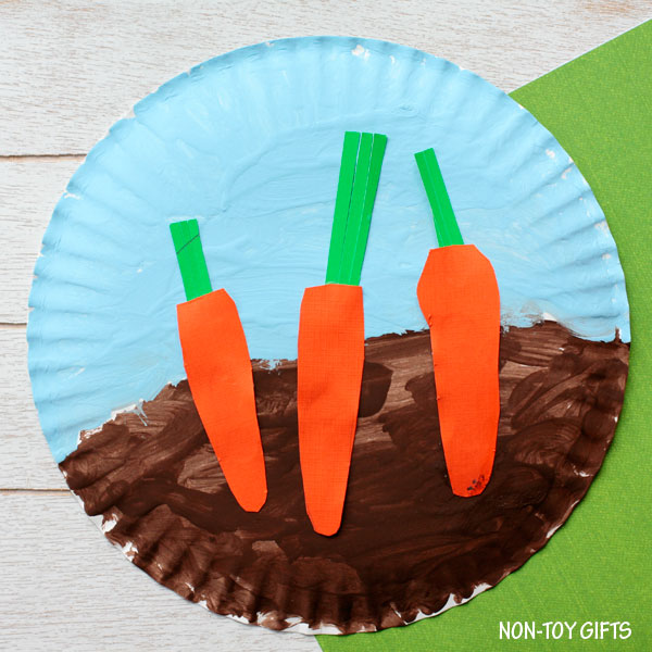 Easy paper plate carrot craft for toddlers, preschoolers and older kids to try this spring or Easter. Carrots in the garden. | at Non-Toy Gifts