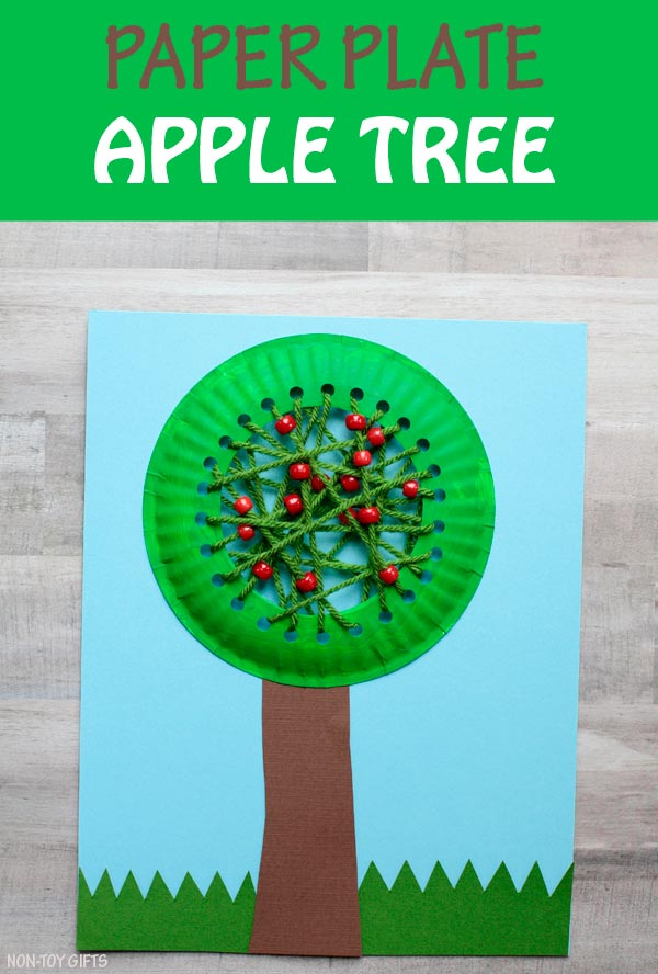 Paper plate apple tree craft for kids to try this fall. Learning about apples? Craft this fall tree with yarn and pony beads. | at Non-Toy Gifts