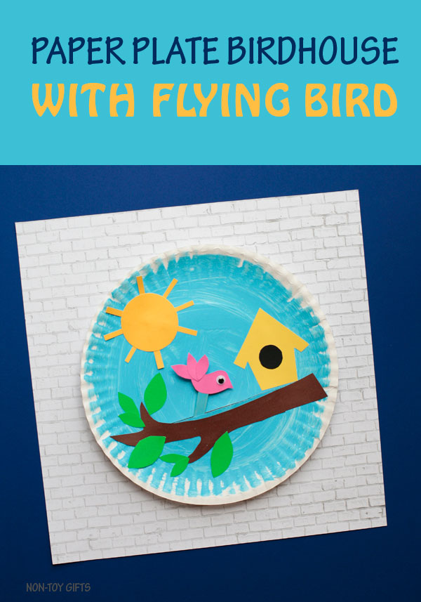 Paper plate birdhouse craft for kids. It has a flying bird glued on a stick that kids can move along the tree branch. Fun spring or summer craft. | at Non-Toy Gifts
