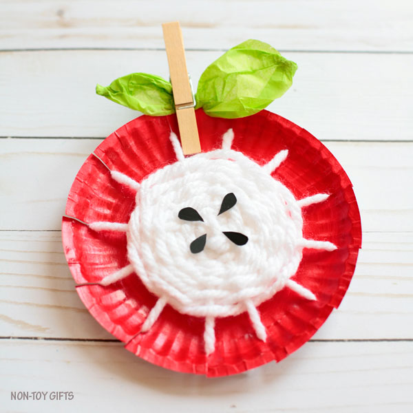 Paper plate yarn weaving craft for kids to try this fall.