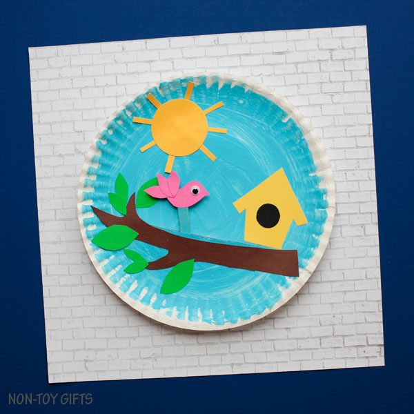 Paper plate birdhouse craft with moving bird