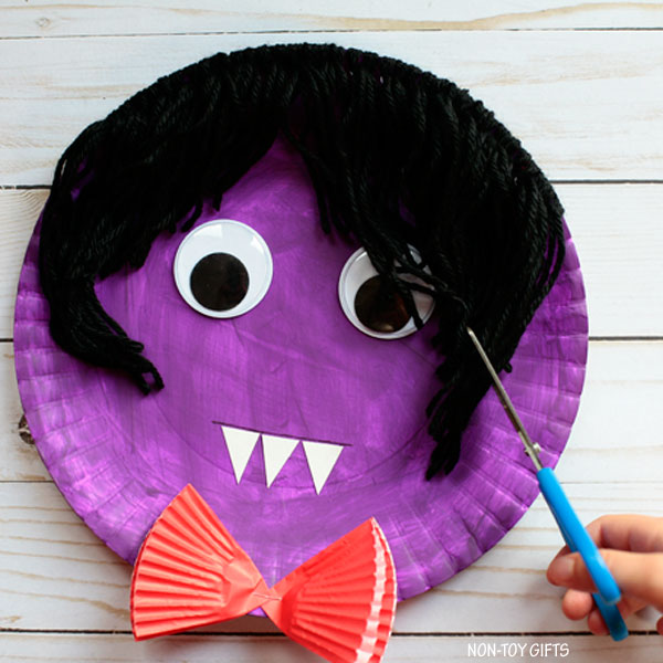 Vampire haircut craft - yarn and paper plate vampire craft