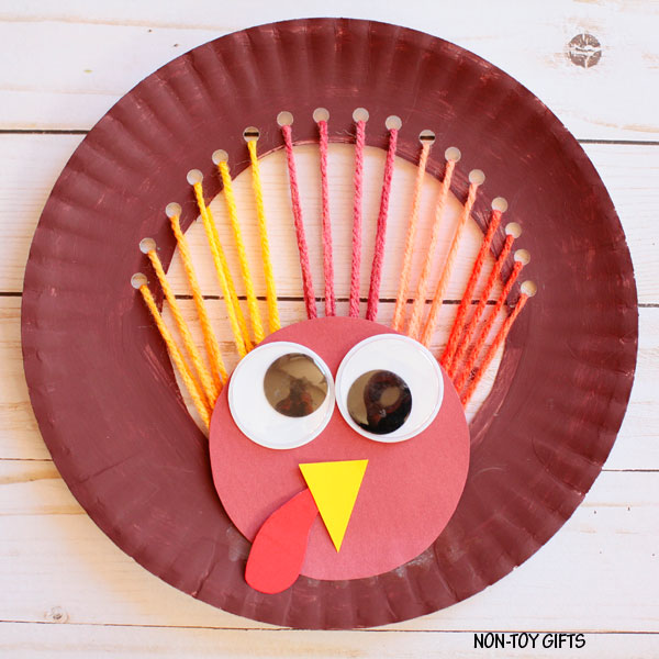 Yarn and paper plate turkey craft for kids