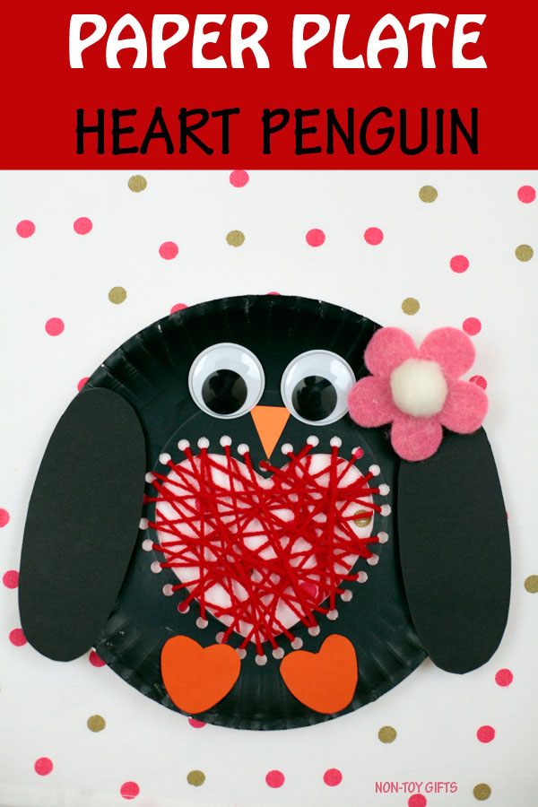 Paper plate heart penguin craft to make with kids on Valentine's Day. Cute winter craft with yarn. #penguins #valentinesday #valentinecraft