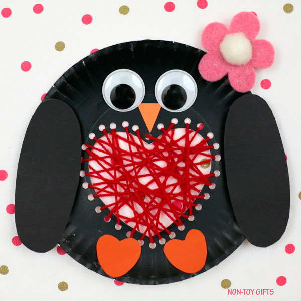 Paper plate penguin with a yarn heart
