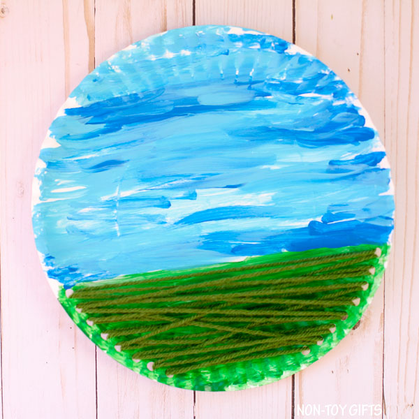Yarn and paper plate flower craft for kids
