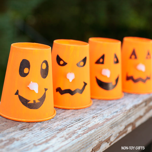 Paper cup and light candle Jack'O'Lantern