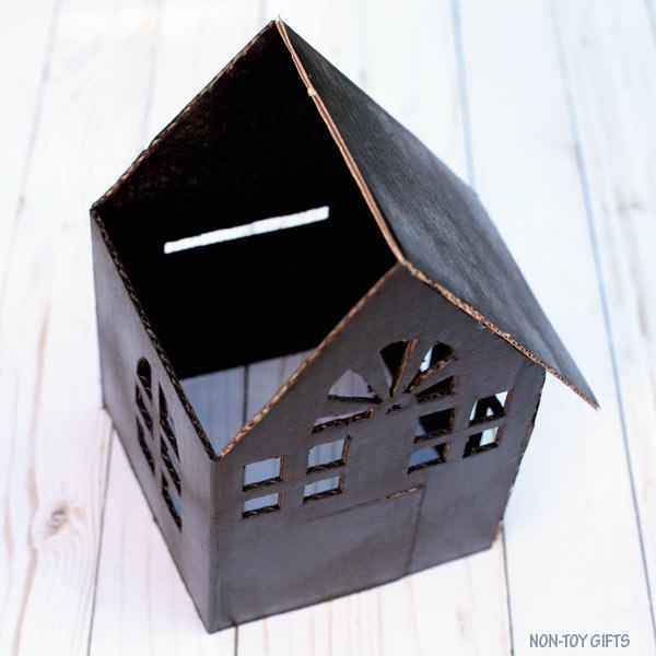 DIY cardboard haunted house luminaries . Glue the roof @Amazon