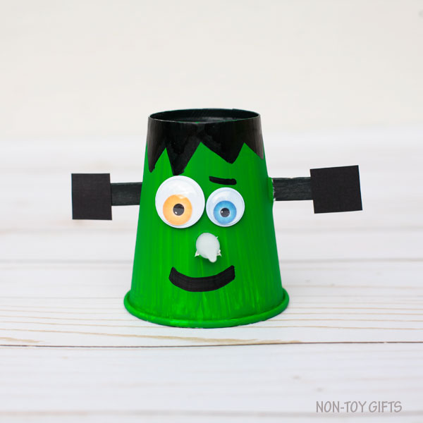 Paper cup Frankenstein with glowing nose