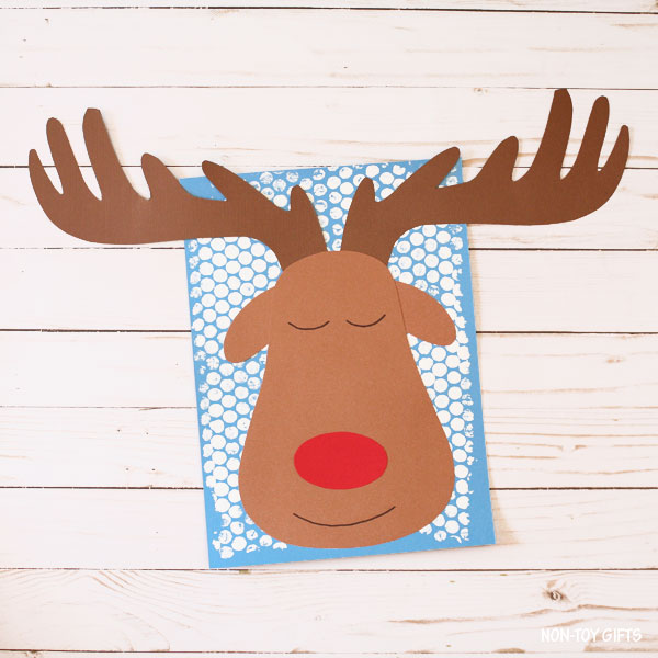 Sleeping reindeer on blue paper