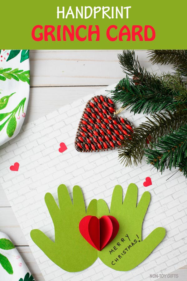 Handprint Grinch card. Easy Christmas craft for preschoolers, kindergartners and older kids. #Grinch #Christmas