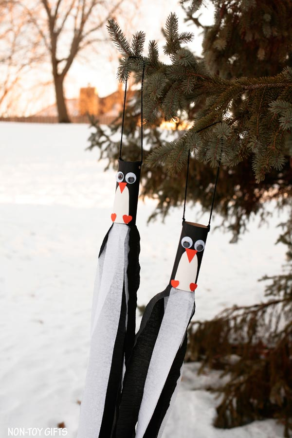 Paper roll penguin windsocks for kids to make