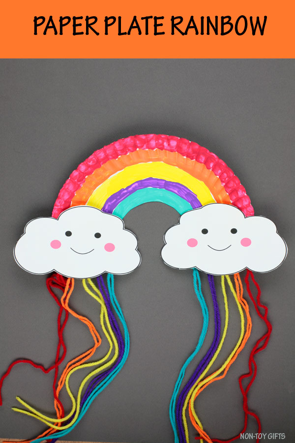 Paper plate rainbow craft for preschoolers and older kids. Use yarn and the free could printable template. Easy paper spring craft. #rainbowcraft #paperplatecraft #nontoygifts #yarncraft
