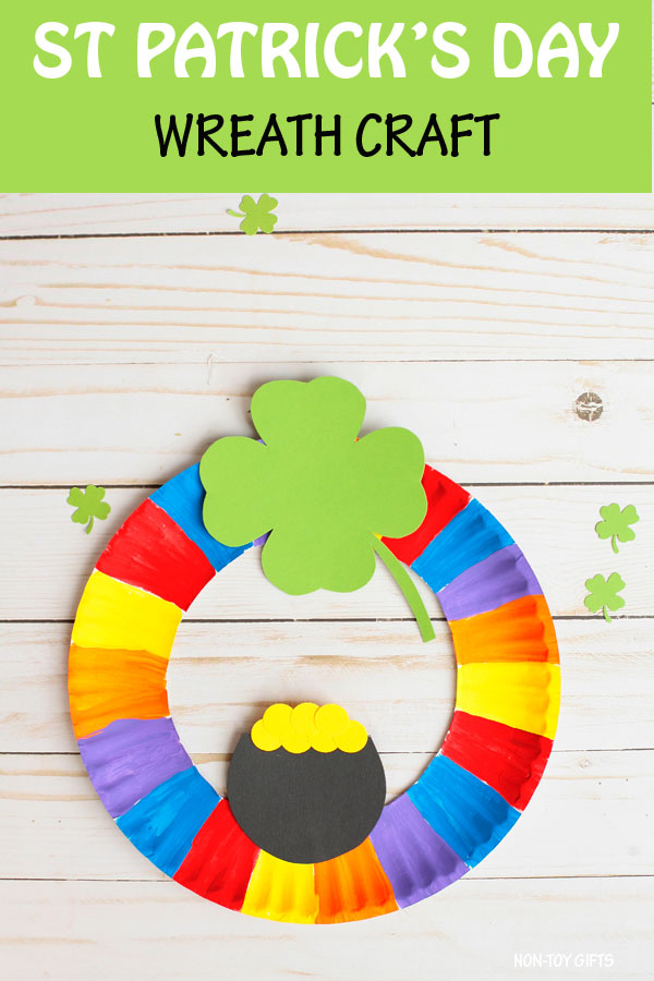 St Patrick's Day wreath craft for kids. Paper plate rainbow, shamrock and pot of gold craft. #nontoygifts #paperplate #stpatricksday #wreath