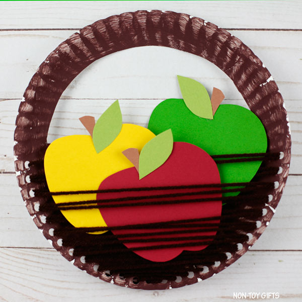 Easy paper plate and yarn apple basket craft for kids