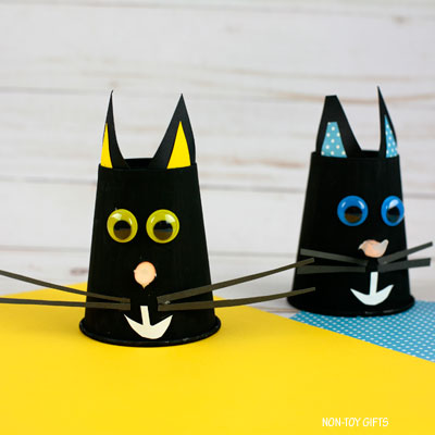 Paper cup black cat with glowing nose