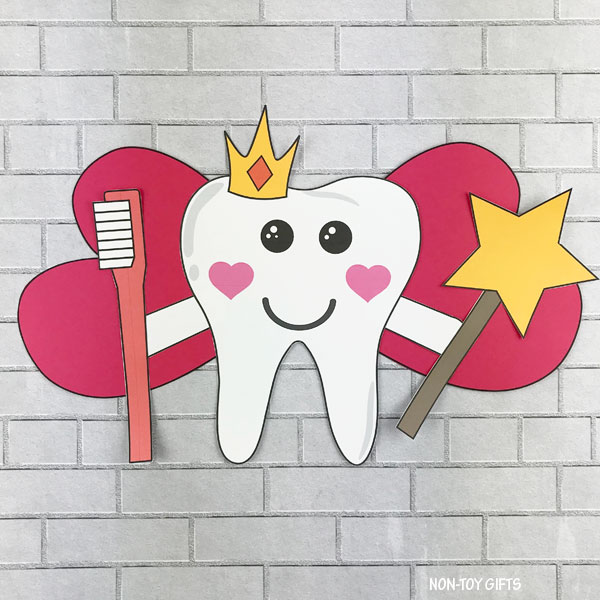 Tooth fairy with magic wand and toothbrush