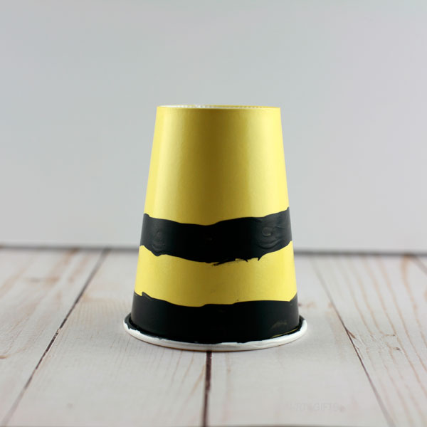 yellow cup with black stripes