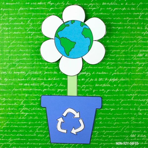 Earth flower growing in a recycling flowerpot