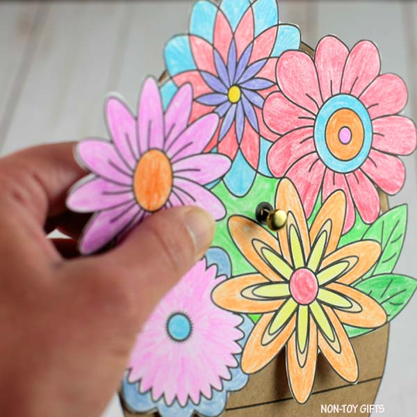attach the flowers and bouquet paper together
