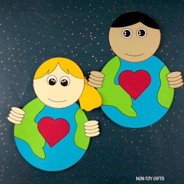 boy and girl holding our Earth craft